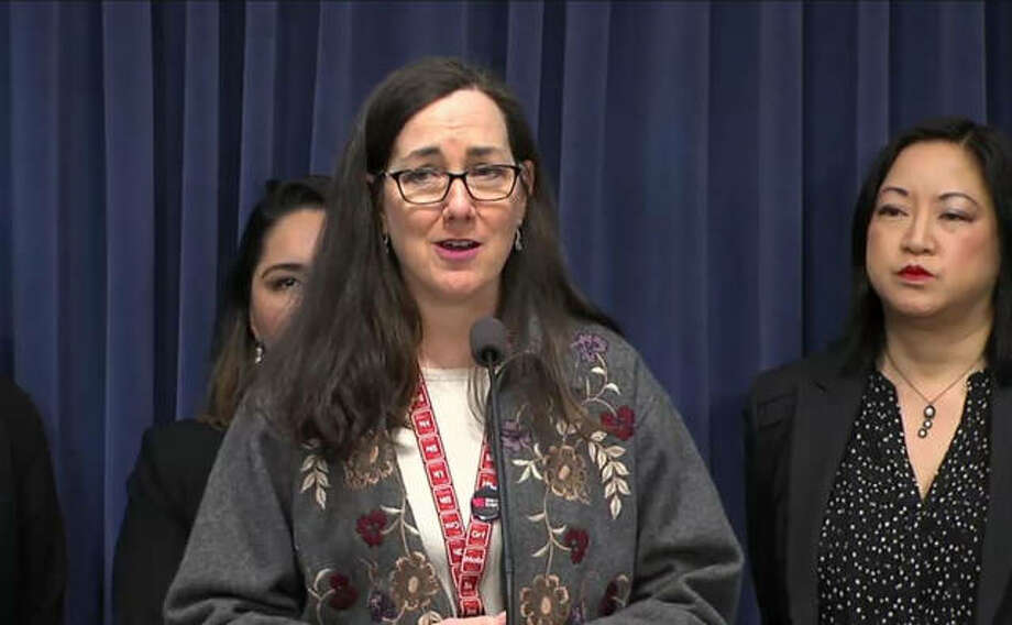 Rep. Kelly Cassidy speaks at a press conference Thursday at the Illinois State Capitol. Also pictured is Rep. Theresa Mah. The group discussed several pro-immigrant measures. Photo: Blue Room Stream