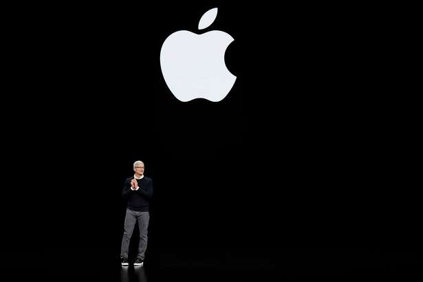 Apple CEO Tim Cook speaks at the Steve Jobs Theater during an event to announce new products Monday, March 25, 2019, in Cupertino, Calif.