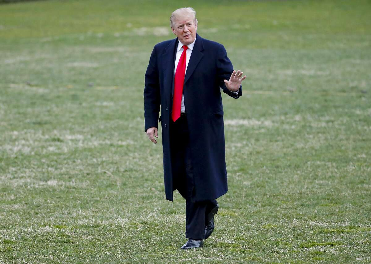President Donald Trump gestures while walking across the South Lawn of the White House in Washington after stepping off Marine One helicopter, Sunday, March 24, 2019, in Washington. The Justice Department said Sunday that special counsel Robert Mueller's investigation did not find evidence that President Donald Trump's campaign