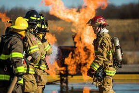 Future firefighters gain experience during a training exercise hosted by Hemlock Semiconductor on Monday, March 25, 2019 at HSC's live fire training facility. (Katy Kildee/kkildee@mdn.net)