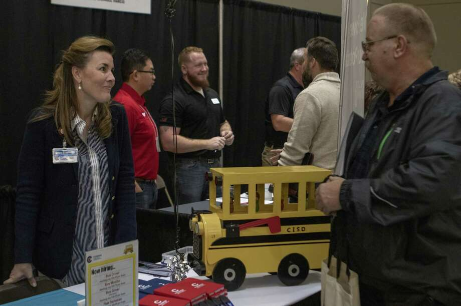 Conroe ISD's annual professional job fair is to take place from 9 a.m. to noon April 6 at Grand Oaks High School. Here, Conroe ISD auxiliary recruiter Kristy Stavinoha speaks with prospective bus drivers during the 7th annual Conroe Lake Conroe Chamber Job Fair on Tuesday, Jan 29, 2019 at the Lone Star Convention and Expo Center in Conroe. Photo: Cody Bahn, Houston Chronicle / Staff Photographer / © 2018 Houston Chronicle