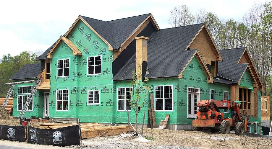 A Toll Brothers home under construction in Danbury, Conn. in May 2017. Toll Brothers is one of 100 publicly traded companies whose stocks are indexed in the HOMZ exchange-traded fund that debuted this month by Norwalk-based Hoya Capital Real Estate. Photo: Chris Bosak / Hearst Connecticut Media / The News-Times