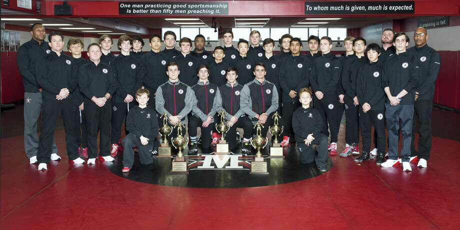The St. John's School wrestling team repeated as SPC champions in 2019, also winning the Texas Prep State title and its first Texas State Duals crown. The Mavericks added their first All-Americans at the National Prep Wrestling Championships. Photo: St. John's School / St. John's School