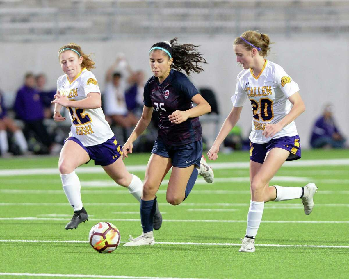 Gabriela Rodriguez (25) of Tompkins is pressured by two McAllen defenders during the second half of a high school soccer game between the Tompkins Falcons and the McAllen Bulldogs in the I-10 Shootout on Saturday, January 12, 2019 at Legacy Stadium, Katy, TX.