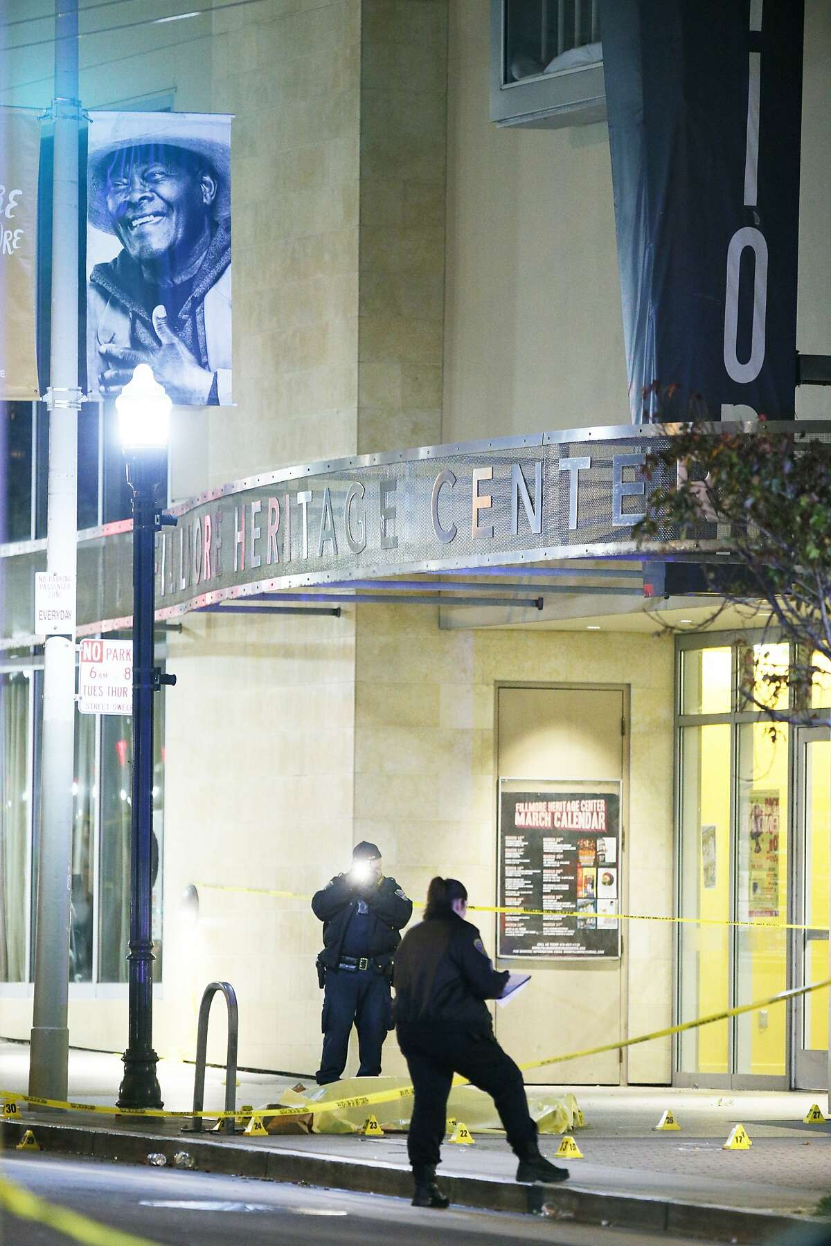 A body bag at the scene of a shooting outside the Fillmore Heritage Center as police investigate the area on Saturday, March 23, 2019, in San Francisco, Calif. Police said one is dead and several injured after a shooting.