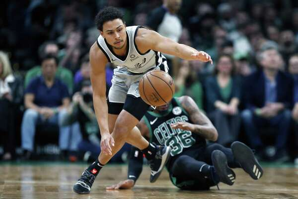 San Antonio Spurs' Bryn Forbes (11) chases a loose ball in front of Boston Celtics' Marcus Smart (36) during the first half of an NBA basketball game in Boston, Sunday, March 24, 2019 (AP Photo/Michael Dwyer)