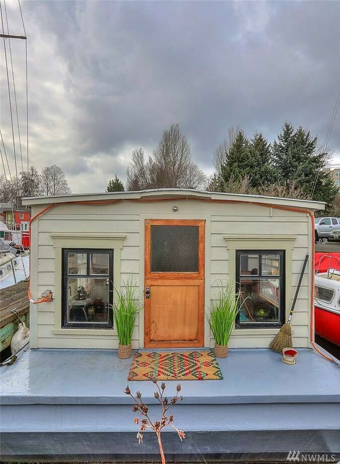 Own your moorage with this charming floating home studio, lovingly rebuilt in 2012 with Craftsman wood-detailing. Next to the bike trail, Gas Works Park, and minutes from U.W.