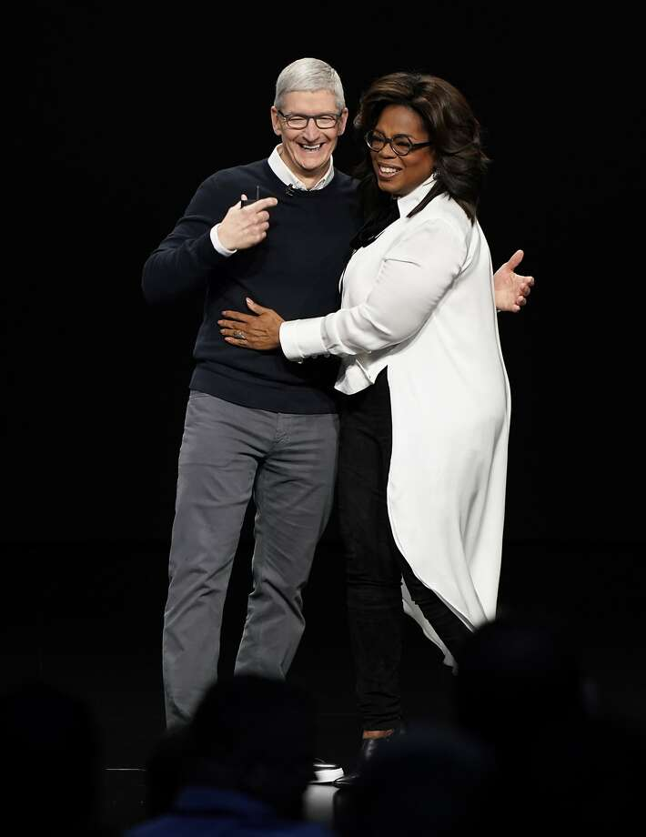 Top: Apple CEO Tim Cook and Oprah Winfrey appear at the Steve Jobs Theater during Apple's event to announce new products. Photo: Tony Avelar / Associated Press