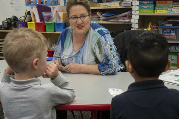 Holley Chandler works with some of her pre-k students 03/25/2019 at Rusk Elementary. Tim Fischer/Reporter-Telegram