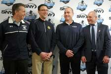 From left: Yale head coach Keith Allain, Quinnipiac associate head coach Bill Riga, UConn head coach Mike Cavanaugh and Sacred Heart head coach C.J. Marottolo stand together during a press conference at Webster Bank Arena in Bridgeport on Monday. The Connecticut Ice hockey tournament and festival, involving the men's hockey teams from all four schools, will be held at the arena in January 2020.