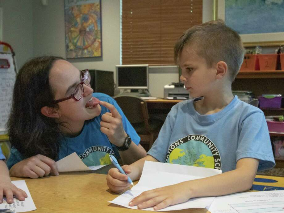 "Language coordinator Nicole Puig assists Elias Gardeen with making a rolling ""r"" sound Friday, March 22, 2019 at All Nations Community School in The Woodlands. Photo: Cody Bahn, Houston Chronicle / Staff Photographer / © 2018 Houston Chronicle"