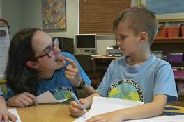"""Language coordinator Nicole Puig assists Elias Gardeen with making a rolling """"r"""" sound Friday, March 22, 2019 at All Nations Community School in The Woodlands."""