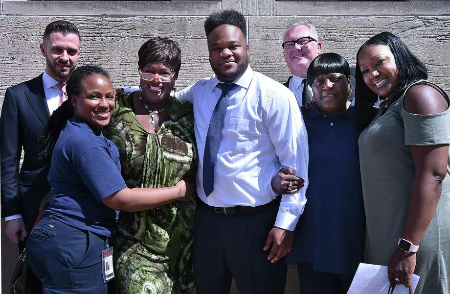 Marquis Jackson, 39, outside of the New Haven Superior Court at 235 Church St., New Haven is photographed with his sister, Dennika Erkerd, his aunt Lorraine Spann, mother, Mary Gamble, his sister Dennisha Jackson and two of his three attorneys Daniel F. Lage, at left, and Jay Ruane, at right, following Jackson's release May 2, 2018, after serving 19 years for a crime he did not commit. Photo: Catherine Avalone / Hearst Connecticut Media File Photo / New Haven Register