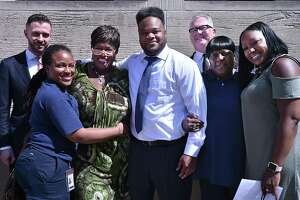 Marquis Jackson, 39, outside of the New Haven Superior Court at 235 Church St., New Haven is photographed with his sister, Dennika Erkerd, his aunt Lorraine Spann, mother, Mary Gamble, his sister Dennisha Jackson and two of his three attorneys Daniel F. Lage, at left, and Jay Ruane, at right, following Jackson's release May 2, 2018, after serving 19 years for a crime he did not commit.