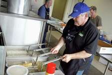 Greg Pierson of Westport works the fryer at the 7th annual Fish Fry at St. Thomas Aquinas Catholic School on Friday, March 22, 2019, in Fairfield, Conn.