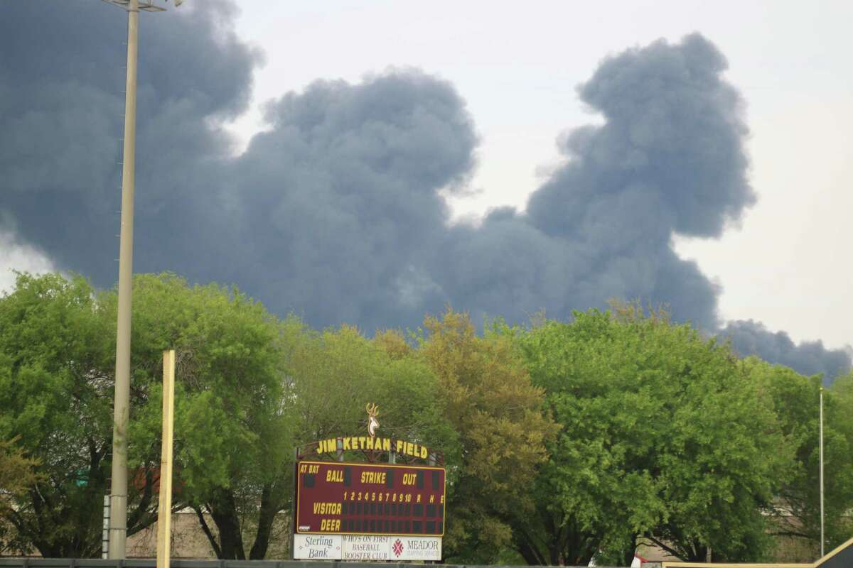 Smoke from the ITC chemical tank farm fire rises over Jim Kethan Field on the second day of the inferno, postponing high school games, cancelling JV games and worst of all, cancelling the city's youth baseball and softball parade this past Saturday.