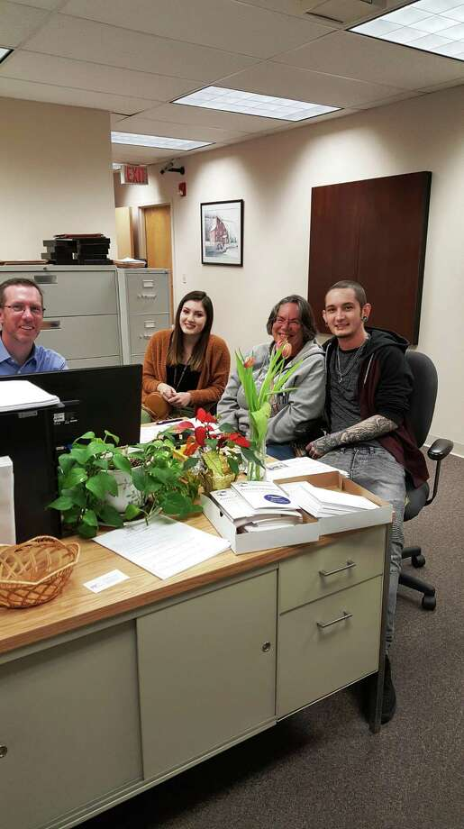 The United Way of Northwest Connecticut's free VITA tax filing program has extended its deadline to April 11, 2019. Above, Bruce Cornish, a VITA volunteer, counsels a family through a tax filing session. Photo: Contributed Photo /