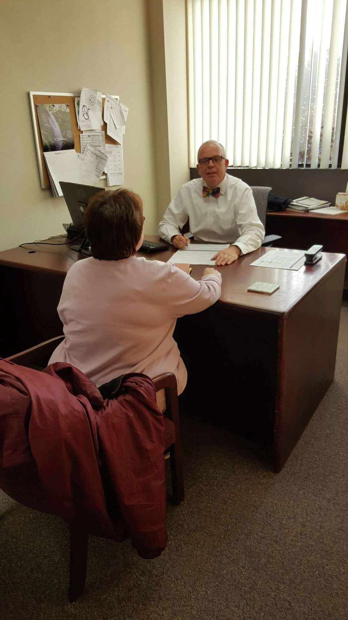 The United Way of Northwest Connecticut's free VITA tax filing program has extended its deadline to April 11, 2019. Above, a resident is counseled through a tax filing session with volunteer Jeff Geddes of Torrington Savings Bank.