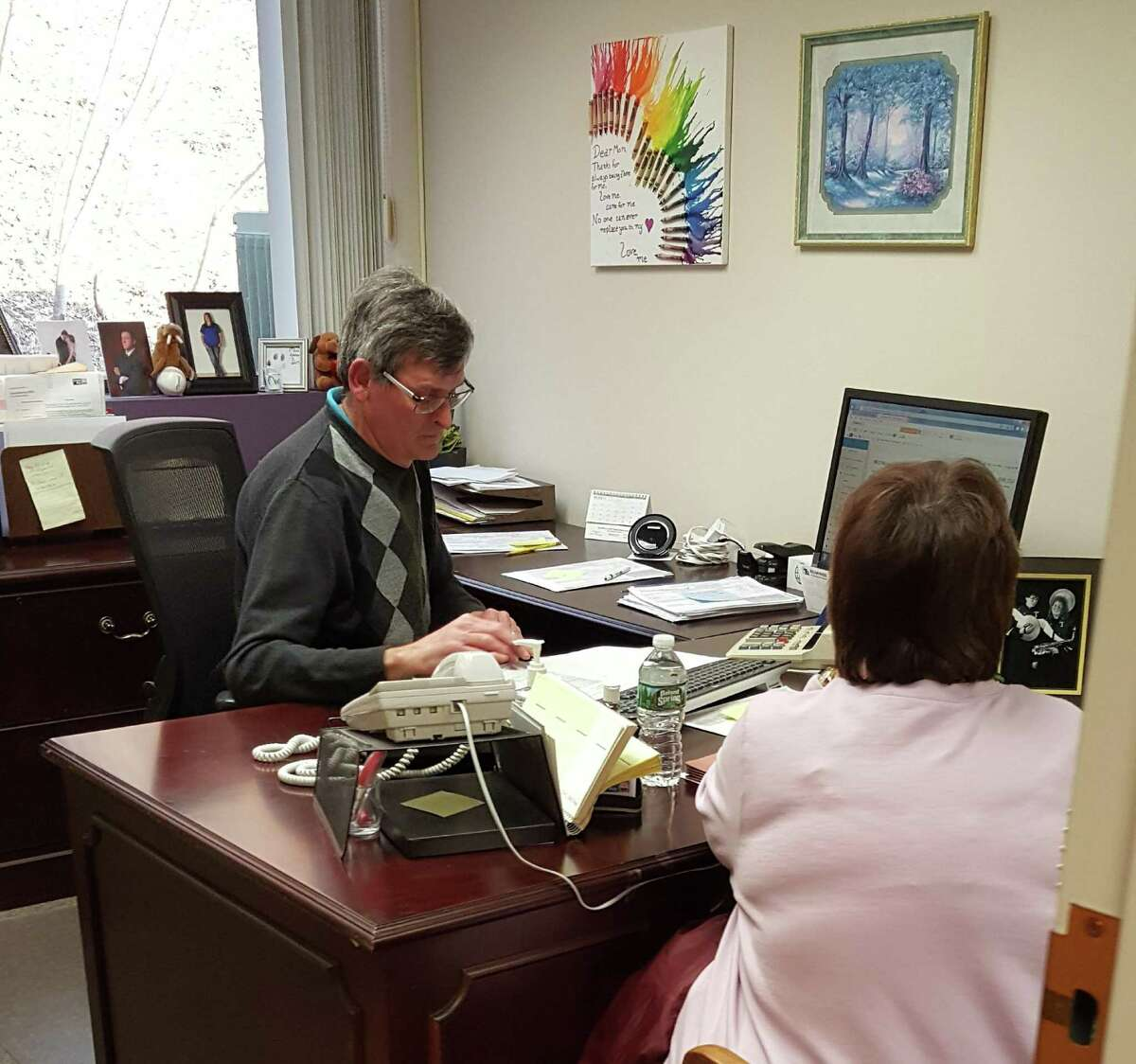 The United Way of Northwest Connecticut's free VITA tax filing program has extended its deadline to April 11, 2019. Above, Torrington Honda's Kevin Sullivan, a volunteer, works with a resident on her tax return.