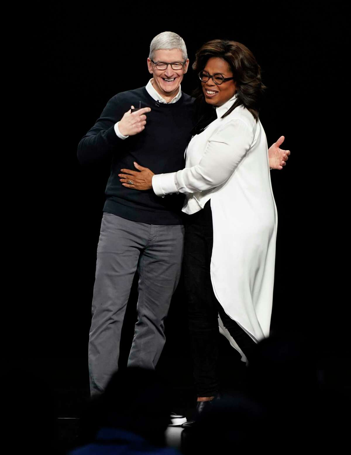 Apple CEO Tim Cook and Oprah Winfrey at the Steve Jobs Theater during an event to announce new products Monday, March 25, 2019, in Cupertino, Calif.