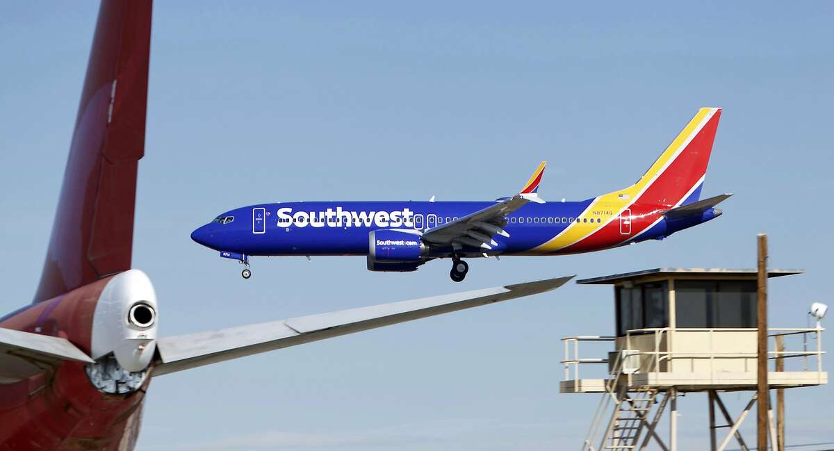 In this Saturday, March 23, 2019 photo, a Southwest Airlines Boeing 737 Max aircraft lands at the Southern California Logistics Airport in the high desert town of Victorville, Calif. Southwest, which has 34 Max aircraft, is making cancellations five days in advance, with an average of 130 daily cancellations. (AP Photo/Matt Hartman)