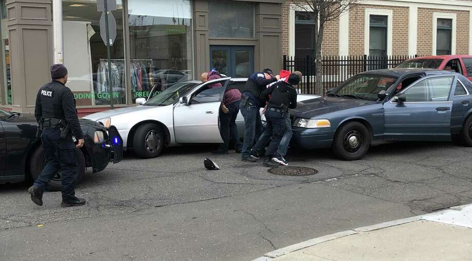 Bridgeport police take a man into custody at the intersection of Lafayette Circle and Cannon Street Monday, March 25, 2019. Photo: Ethan Fry / Hearst Connecticut Media