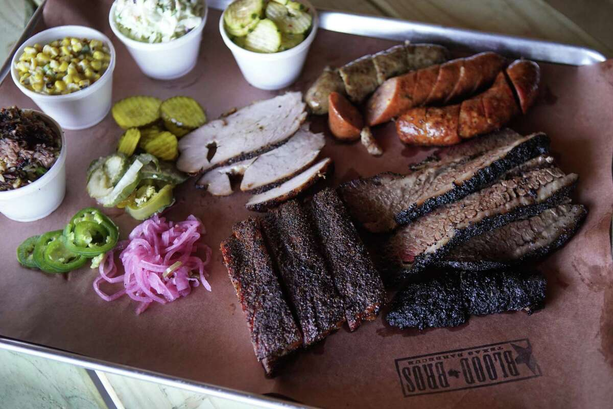 Brisket, ribs, turkey, sausage, sides and condiments at Blood Bros. BBQ in Bellaire. The barbecue restaurant's Asian influences were lauded in Texas Monthly's new list of the top 25 best new barbecue joints.