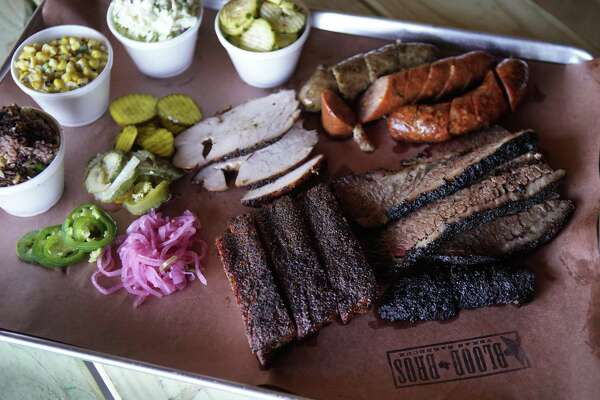 Brisket, ribs, turkey, sausage, sides and condiments at Blood Bros. BBQ