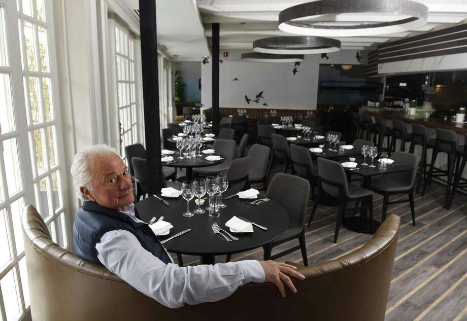 """Owner Ramze Zakka poses at the newly-renovated Mediterraneo restaurant in Greenwich, Conn. Monday, March 25, 2019. """"We've been open here since 1995. The restaurant just needed some new lipstick,"""" said Zakka. The renovation features new floors, ceilings, bathrooms, a streamlined kitchen, oak bar top, metal fixtures and accessories made in Pennsylvania, new furniture and repainted exterior, all staying with a modern Mediterranean theme. The restaurant officially reopens on Tuesday. Photo: Tyler Sizemore / Hearst Connecticut Media / Greenwich Time"""