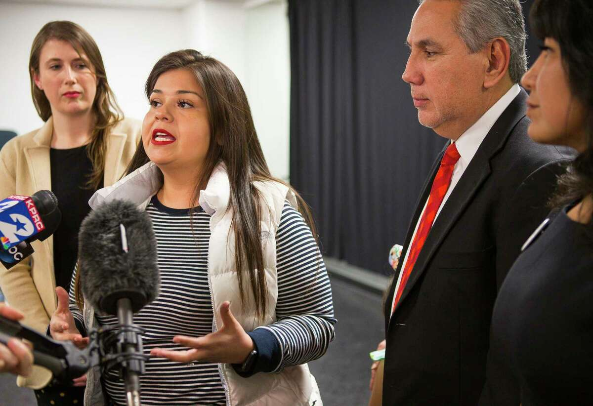 Houston Independent School District board of trustees member Elizabeth Santos (center) is joined by fellow trustees Holly Maria Flynn Vilaseca, Sergio Lira and Diana Dávila as she talks with reporters regarding the news Monday that the Texas Education Agency's state-appointed conservator ordered the board to suspend their search for a permanent superintendent, Monday, March 25, 2019 at Talento Bilingue De Houston.