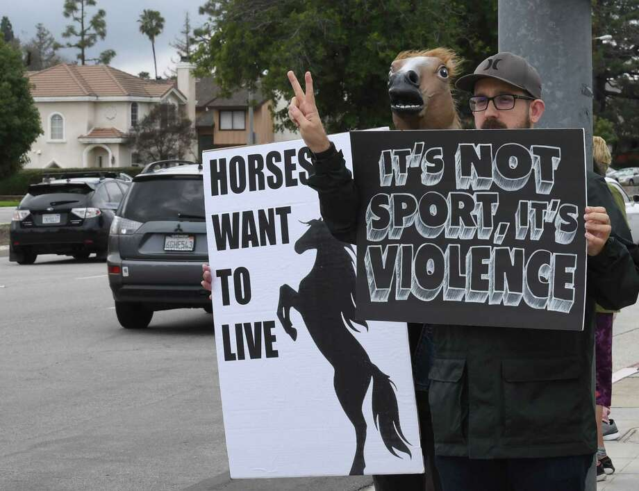 Animal-rights advocates protest the deaths of 20 racehorses in the first two months of this year at the Santa Anita Racetrack in Arcadia, California on March 3, 2019. - Santa Anita averaged more than 55 horse deaths per year from 2008-18, according to data from the California Horse Racing Board, a total of 553 deaths in all, but this year's major rise in deaths is under investigation. (Photo by Mark RALSTON / AFP)MARK RALSTON/AFP/Getty Images Photo: MARK RALSTON / AFP or licensors