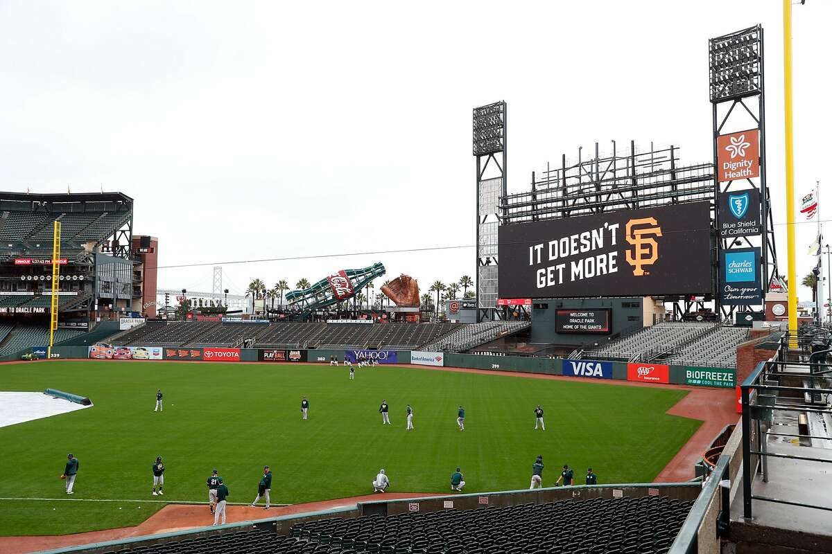 Oakland Athletics warm up with partially constructed new scoreboard in background before playing San Francisco Giants at Oracle Park in San Francisco, Calif., on Monday, March 25, 2019.