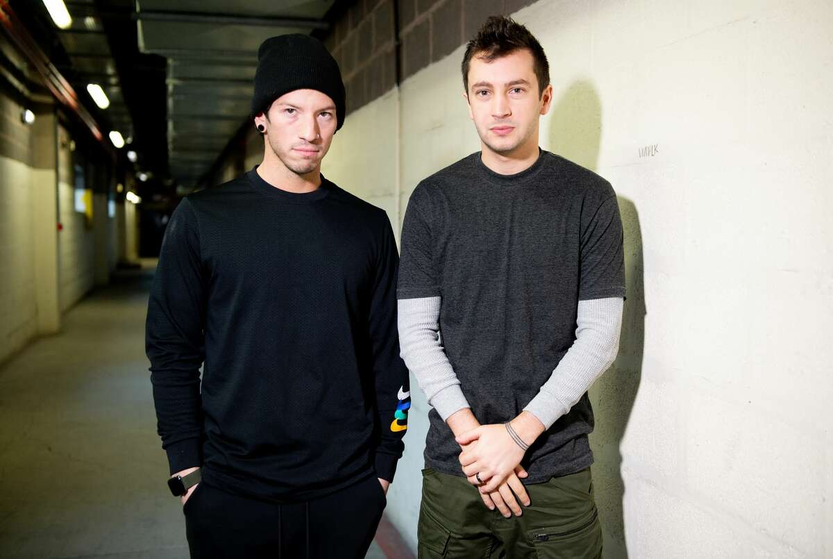 Josh Dun and Tyler Joseph of Twenty One Pilots pose backstage after meeting fans in store at HMV Manchester on March 05, 2019 in Manchester, England.