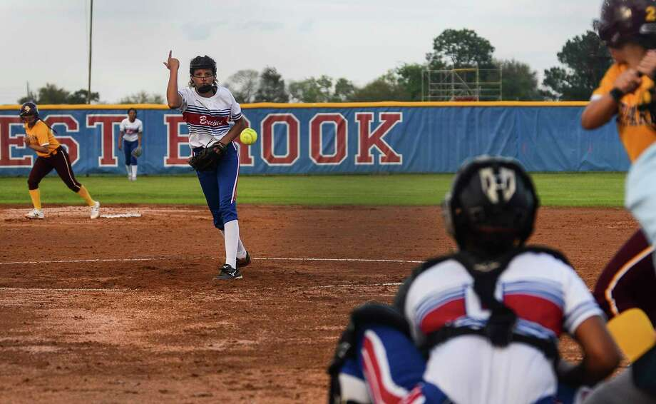 West Brook's Jada Montgomery pitches during a game against Deer Park at West Brook on Monday. Photo taken on Monday, 03/25/19. Ryan Welch/The Enterprise Photo: Ryan Welch, The Enterprise / ©Ryan Welch