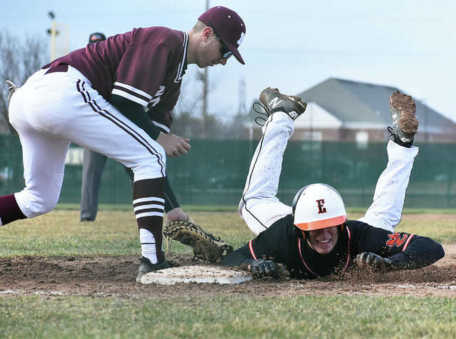 Edwardsville's Joe Copeland dives safely back into first base on a pickoff attempt by Moline during Monday's game at Tom Pile Field. Photo: Matthew Kamp/The Intelligencer