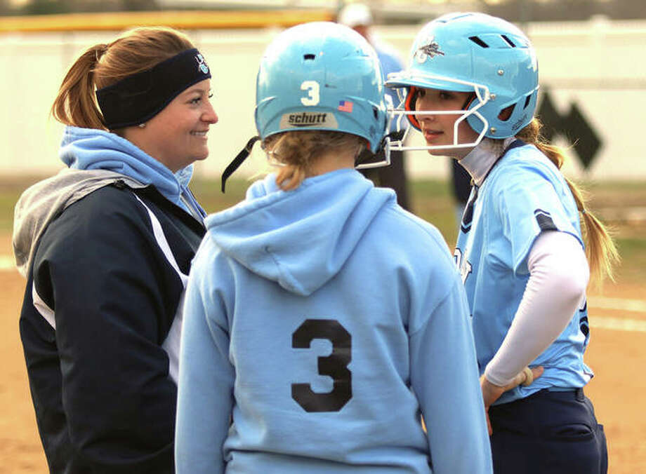Jersey's Brooke Tuttle (right) goes over the situation with coach Chelsey Crnokrak (left) and Panthers baserunner Shelby Koenig during a Bunker Hill meeting on the field Monday in Jerseyville. Photo: Greg Shashack | The Telegraph