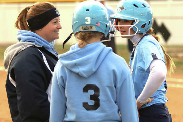Jersey's Brooke Tuttle (right) goes over the situation with coach Chelsey Crnokrak (left) and Panthers baserunner Shelby Koenig during a Bunker Hill meeting on the field Monday in Jerseyville.