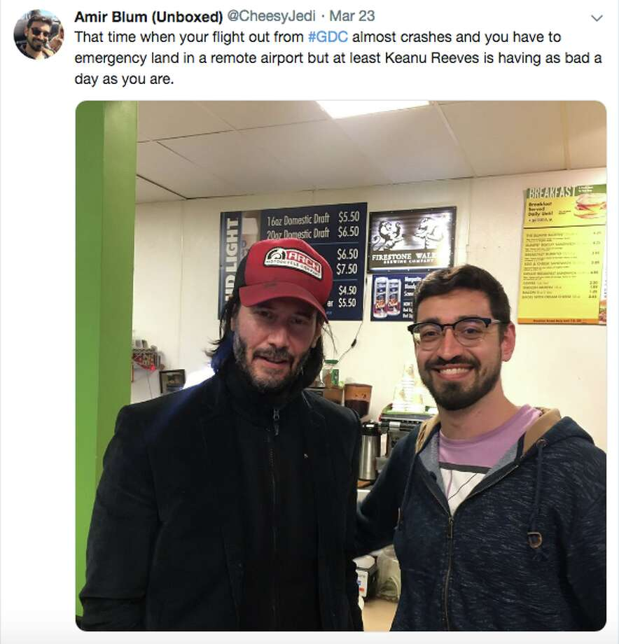 Keanu Reeves poses with a fellow passenger on his stranded flight from SFO to Burbank on Saturday, March 23, 2019. Photo: Screenshot/Amir Blum/@cheesyjedi