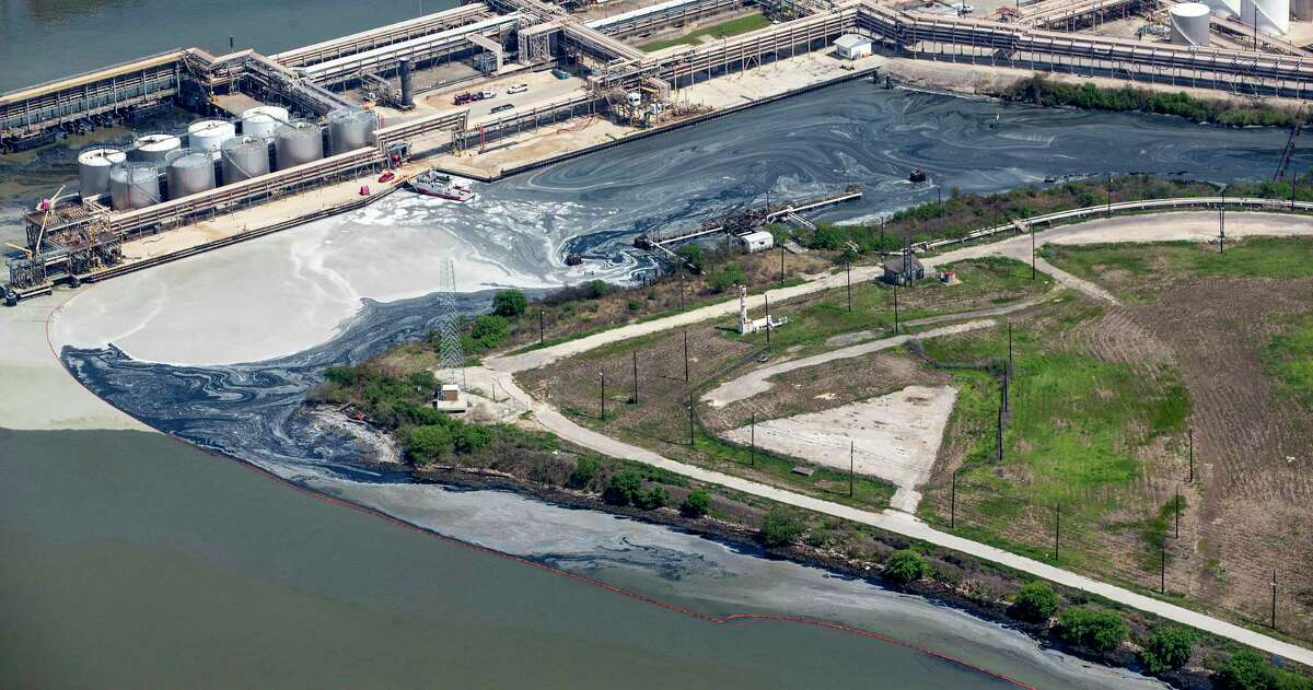 Runoff from the tank fire at Intercontinental Terminals Company is blocked by an oil skimming bouy on Wednesday, March 20, 2019, in Deer Park. Three energy companies that operate in the Houston Ship Channel are suing Intercontinental Terminals Company over the fire last year that resulted in temporary closure of the channel.