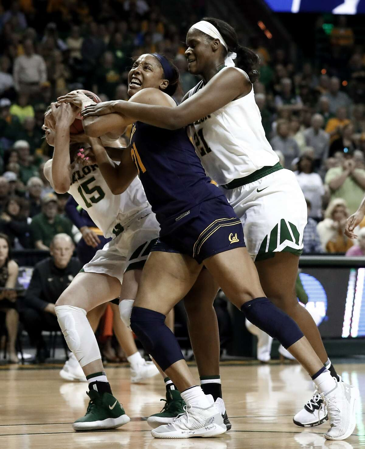 Baylor's Lauren Cox (15) and Kalani Brown, right, combine to strip the ball away from California center Kristine Anigwe (31) in the first half of a second-round game in the NCAA women's college basketball tournament in Waco, Texas, Monday, March 25, 2019. (AP Photo/Tony Gutierrez)