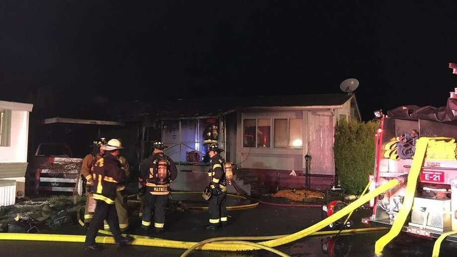 A firefighter and a resident were hurt in a mobile home fire early Tuesday morning in unincorporated Lynnwood. (Photo credit: Steve Miller) Photo: KOMOnews.com