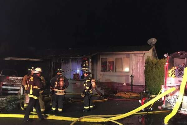 A firefighter and a resident were hurt in a mobile home fire early Tuesday morning in unincorporated Lynnwood. (Photo credit: Steve Miller)