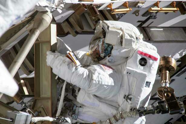A photo provided by NASA of Anne McClain working on the International Space Station's Port-4 truss structure during a 6-hour 39-minute spacewalk to upgrade the station's power storage capacity. McClain was scheduled to participate with Christina Koch in the first all-female spacewalk, but McClain's assignment was readjusted because only one medium-size torso component is readily available at the International Space Station. (NASA via The New York Times) -- FOR EDITORIAL USE ONLY --