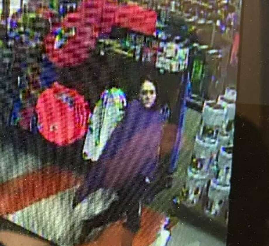 North Haven police are asking for help identifying a woman who allegedly took $800 worth of merchandise from Dick's Sporting Goods. Photo: North Haven Police Department