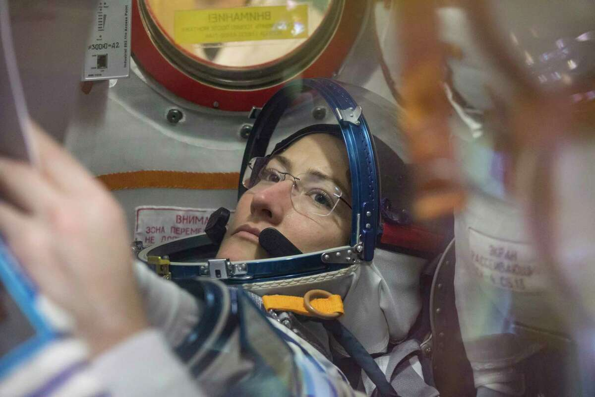 A photo provided by NASA of Christina Koch working inside the Soyuz MS-12 spacecraft at the Baikonur Cosmodrome in Kazakhstan. Koch is scheduled to do her first spacewalk on Friday, but not with another female astronaut as had previously been planned because only one medium-size torso component is readily available at the International Space Station.