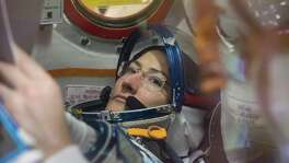 A photo provided by NASA of Christina Koch working inside the Soyuz MS-12 spacecraft at the Baikonur Cosmodrome in Kazakhstan. Koch is scheduled to do her first spacewalk on Friday, but not with another female astronaut as had previously been planned because only one medium-size torso component is readily available at the International Space Station. (Victor Zelentsov/NASA via The New York Times) -- FOR EDITORIAL USE ONLY --