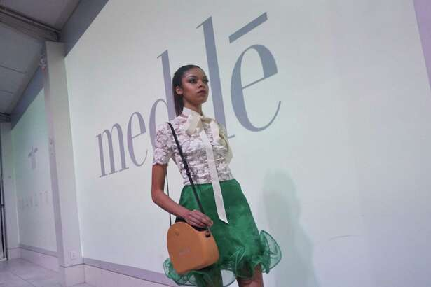 Handbags from med•le accessorize a model in Trang Tram at the med•le launch party and fashion show March 23, 2019 in Houston, TX.