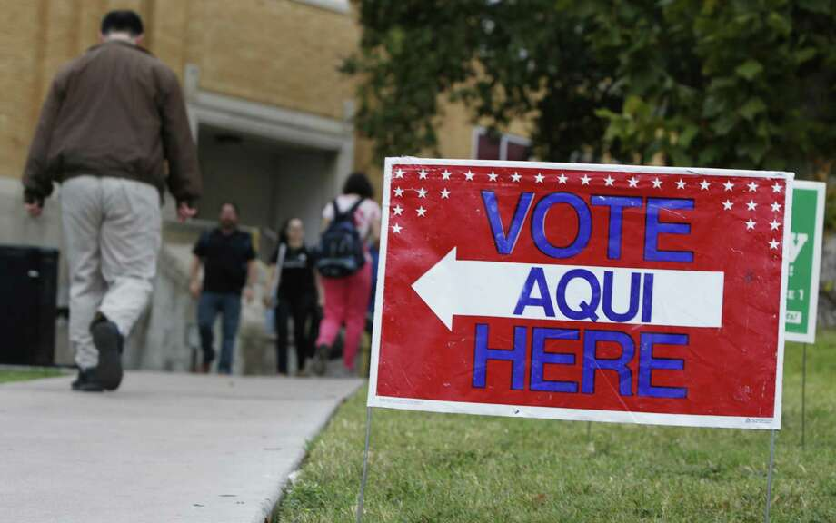 A sign shows the way to the polling station at Austin Community College on November 4, 2014 in Austin, Texas. Voters headed to the polls today to decide a number of tight races. (Photo by Erich Schlegel/Getty Images) Photo: Erich Schlegel, Stringer / Getty Images / 2014 Getty Images