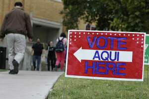 A sign shows the way to the polling station at Austin Community College on November 4, 2014 in Austin, Texas. Voters headed to the polls today to decide a number of tight races. (Photo by Erich Schlegel/Getty Images)