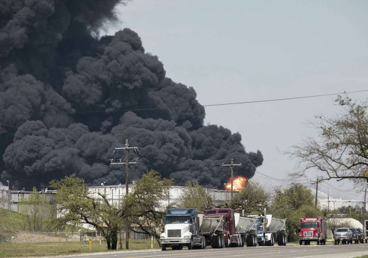 A plume of smoke rises in the air following a fire at the Intercontinental Terminals Co (ITC) petrochemical storage site in City, Texas, U.S., on Tuesday, March 19, 2019. As a towering plume of black smoke billowed a mile above Houston for a third day, all attention turned to a concrete wall on the edge of a blazing petrochemical site that was built to hold back millions of gallons of toxic chemicals. Photographer: Scott Dalton/Bloomberg